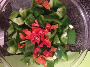 Chopped green bell peppers and habanero chilis