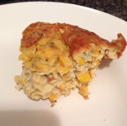 A slice of corn kugel-pashtida on a white plate