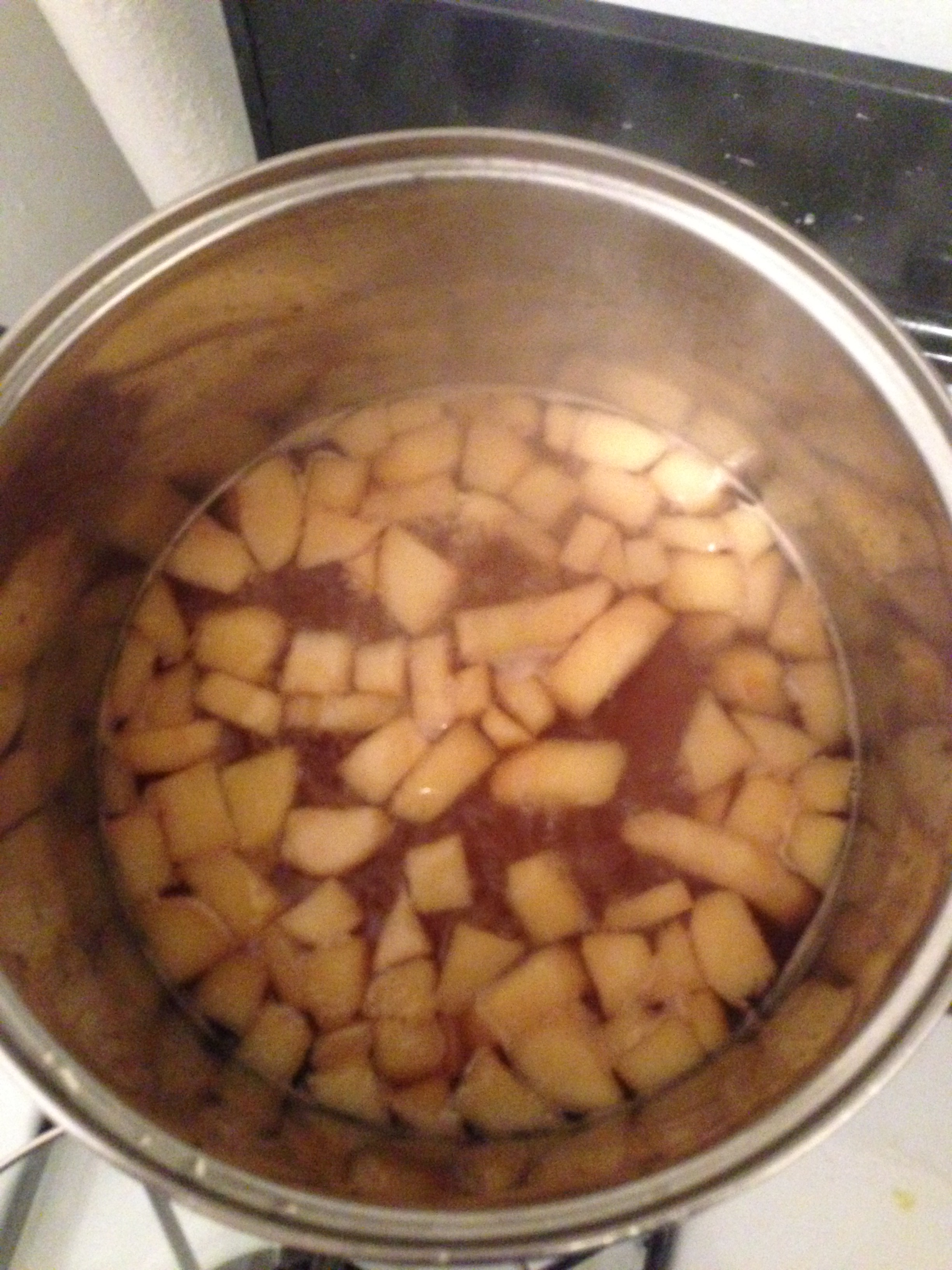 Quinces cooking in syrup