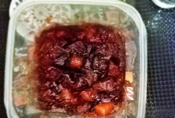 Quince jam in a container