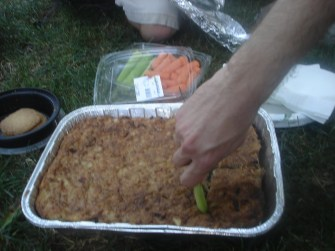 Cutting a kugel with a celery stalk