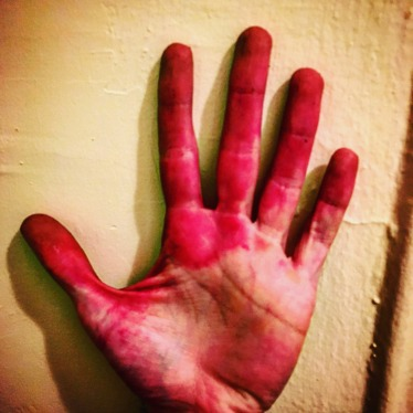 Beet juice stained hand