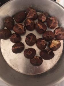 Chestnuts after roasting, in pan, before peeling