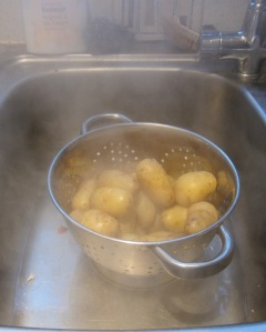 draining cooked potatoes