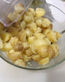 mixing potatoes with marinade