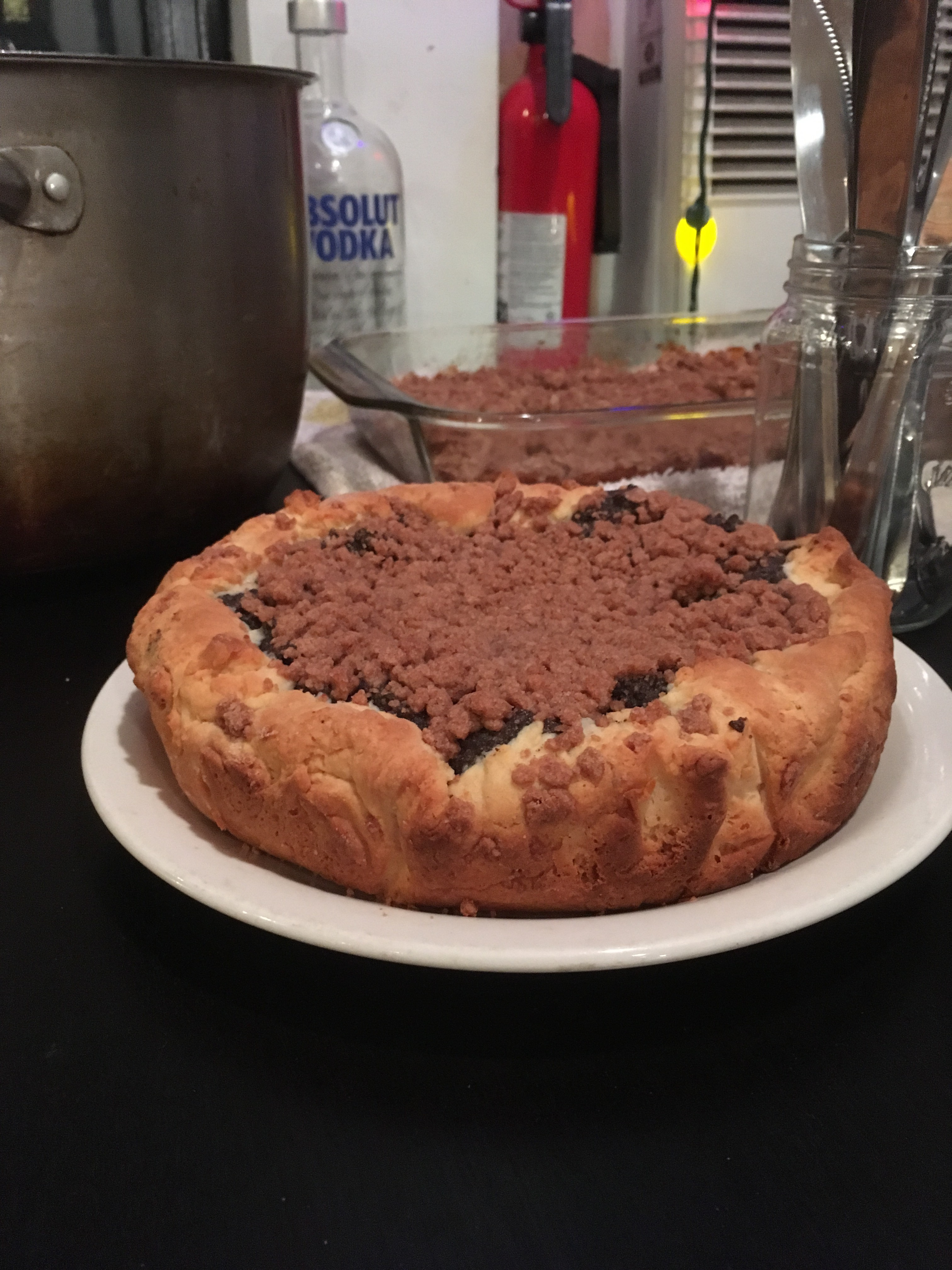 The cake, on a plate, with other dishes in the background