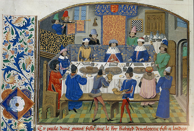 Manuscript illustration of Richard II dining with his dukes in a lavishly decorated dining room.