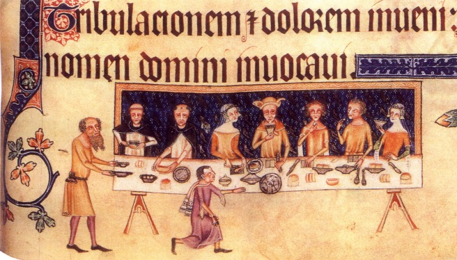 Dining room scene from the Luttrell Psalter - men and women dressed in gold eating confections and drinking, with a bearded servant and a young boy in a scarf attending