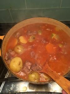 Tamatiebredie stewing in pot