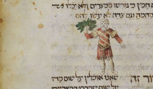 A man holding maror in the Farissol Haggadah with Hebrew text on parchment