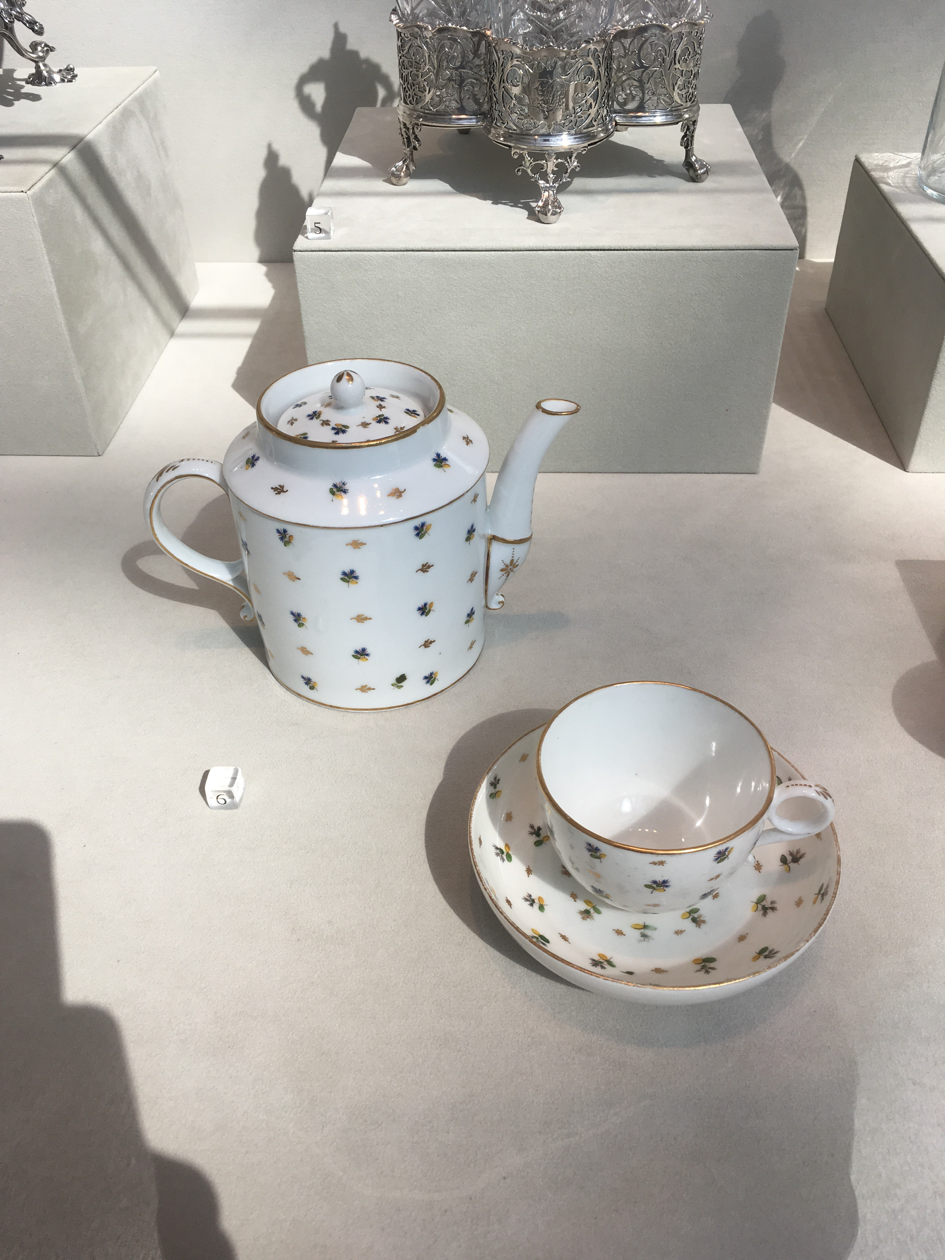 French porcelain teapot, cup and saucer with a gold and black pattern