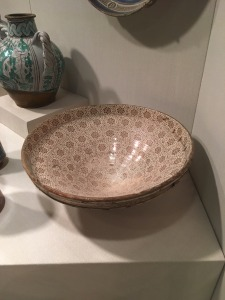 An inlaid bowl from Spain with a geometric pattern and copper luster.