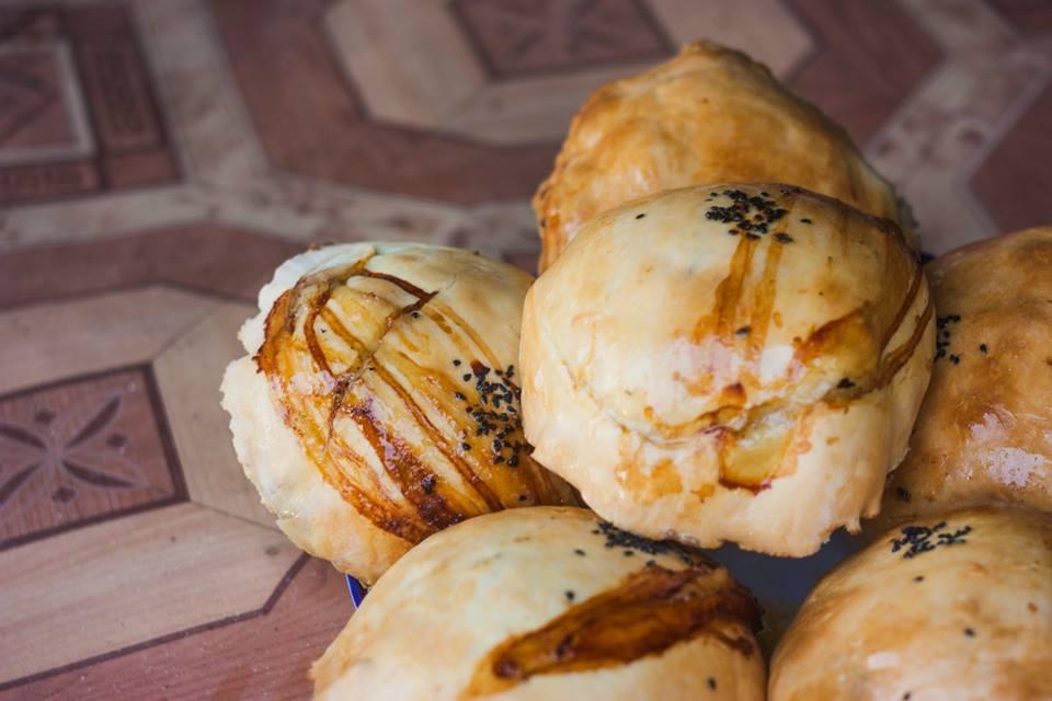 Samsa - a baked triangular bun topped with seeds