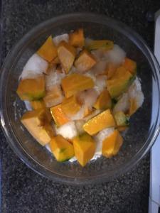 Pumpkin soaking in sugar in a bowl