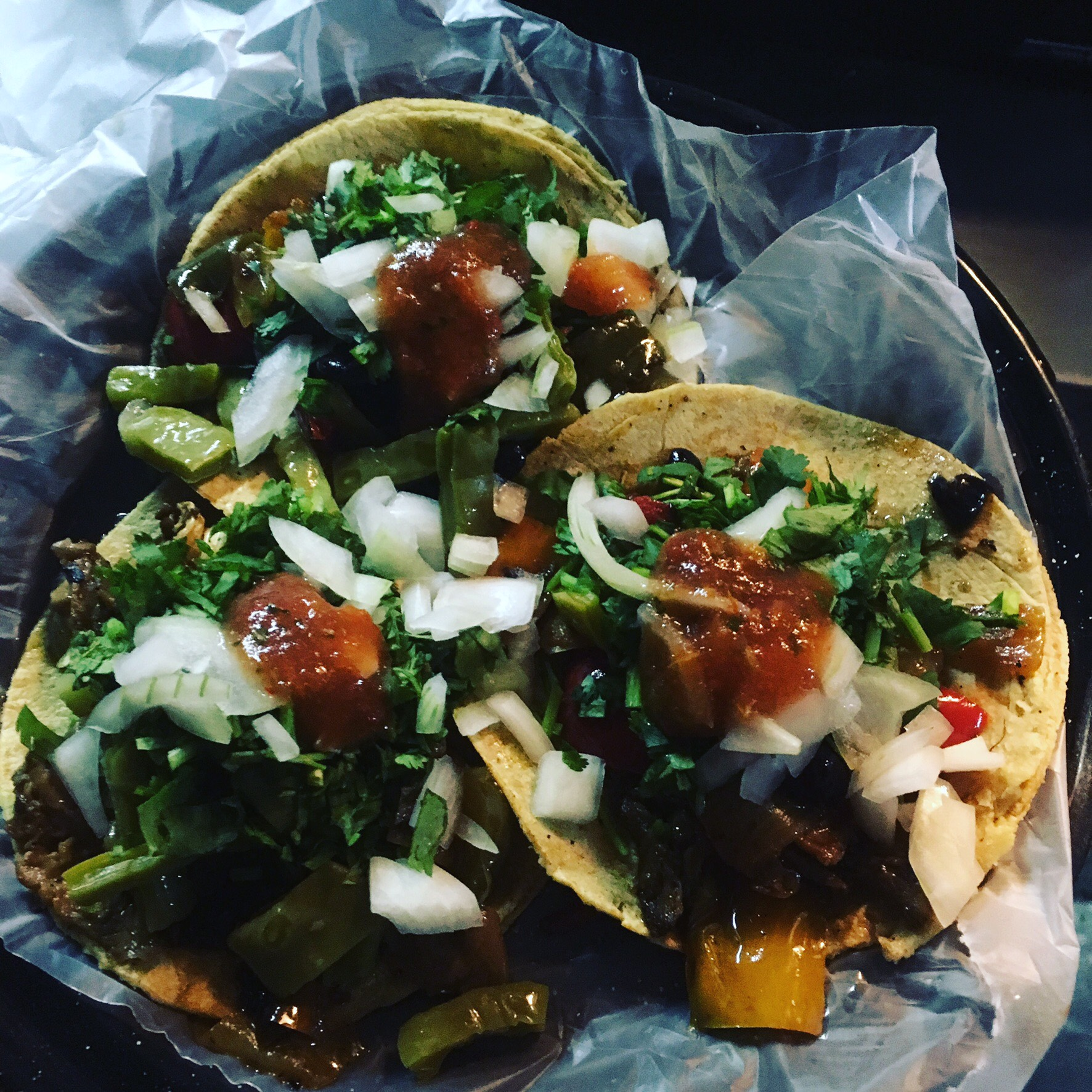 Tacos with salsa onions vegetables and cilantro