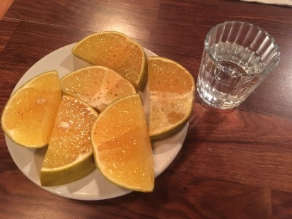 Mezcal and oranges with tajin