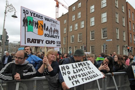 "Disability rights protest in Ireland. Signs include ""10 years waiting for equality ratify CRPD now"" and ""No limbs. No limits. Impossible. I'm possible."""