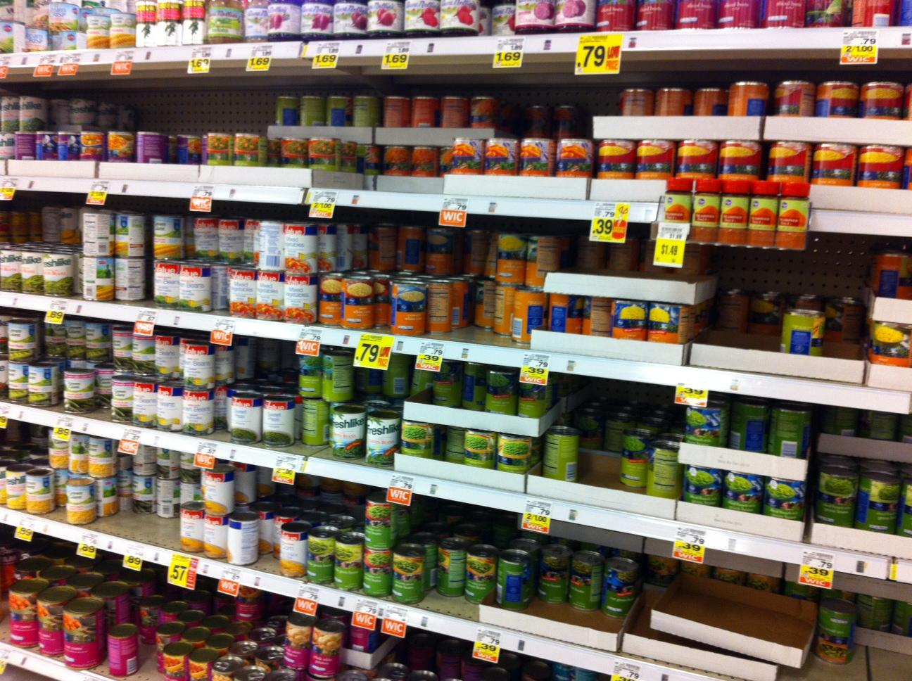 Canned vegetables on a shelf.
