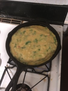 the frittata batter still wet in the pan