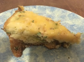 A slice of frittata on a blue plate
