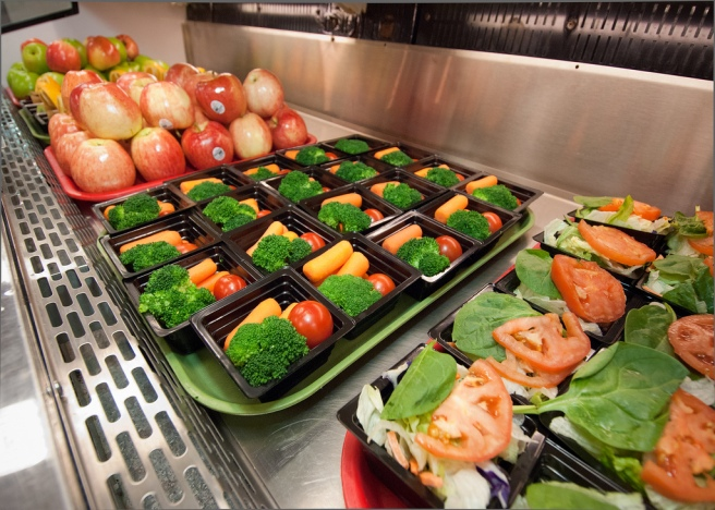 Trays of vegetables and fruit on a metal table