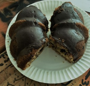 Half of a cherry chocolate Bundt cake with chocolate ganache