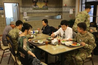 Korean army soldiers and families eating at a US Air Force base