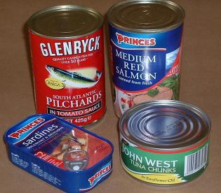 Cans of pilchards, sardines, tuna, and salmon