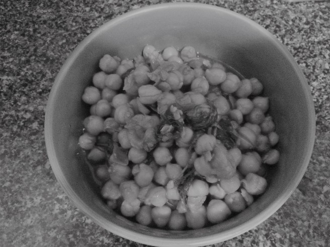 Chickpeas with kale in a bowl in a black and white image