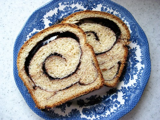 Chocolate babka slices on a blue porcelain patterned plate