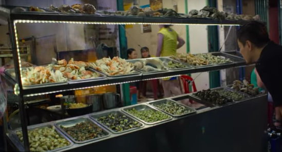 A stall with trays of food