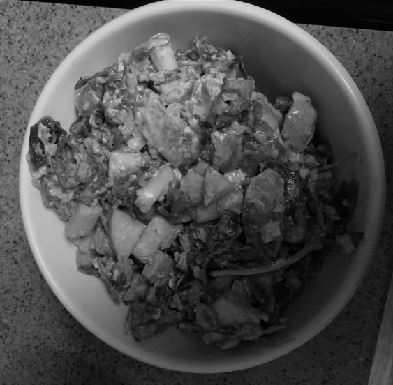 Black and white photo of arugula salad in a bowl