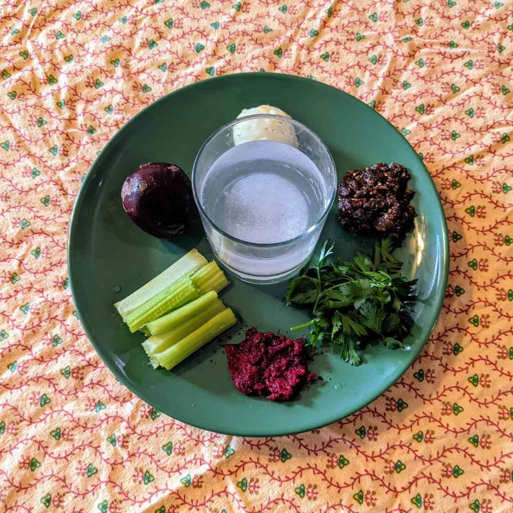 Seder plate with beet instead of bone and a glass of salt water