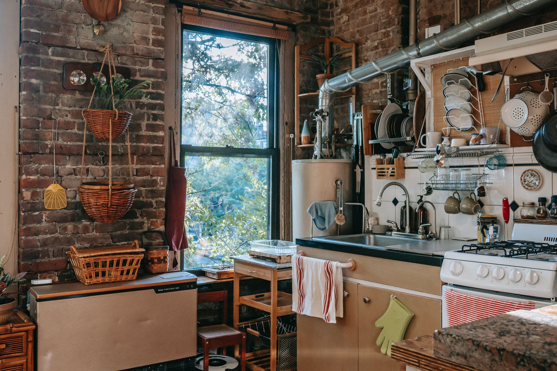 Old kitchen with many implements and a big window